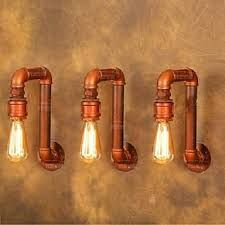 Image result for modern art lightings made by copper pipes