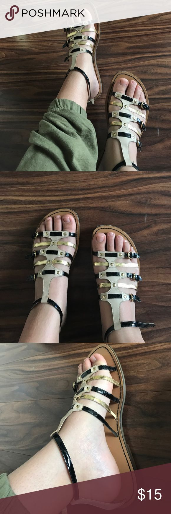 🔥SALE🔥 guess Marciano 8.5 gladiator sandal Not sure if these are real or faux leather. They are cream black and gold in size 8.5. Super cute! Bundle with 2 more items for 30% off. Send offers! Guess by Marciano Shoes Sandals