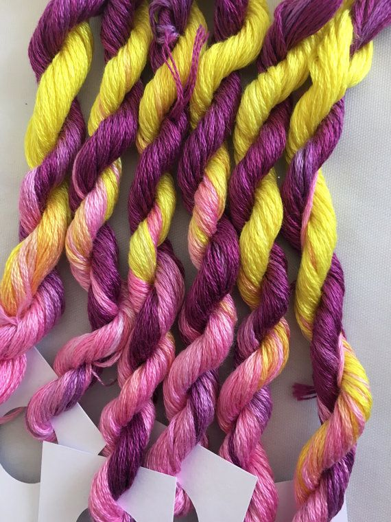 This is my hand dyed thread in the colourway Rhubarb and Custard on 8m DMC six stranded floss for cross stitch or embroidery, or other needlework.