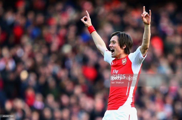 Tomas Rosicky of Arsenal celebrates as he scores their second goal during the Barclays Premier League match between Arsenal and Everton at Emirates Stadium on March 1, 2015 in London, England.