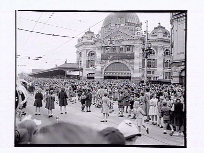 Moomba Parade Melbourne Victoria Australia Flinders St. Railway station in background 1955. The parade is held on Labour Day yearly.