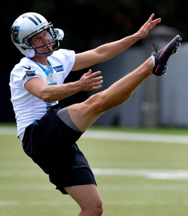 New Carolina Panthers punter Andy Lee watches the flight of the ball during…