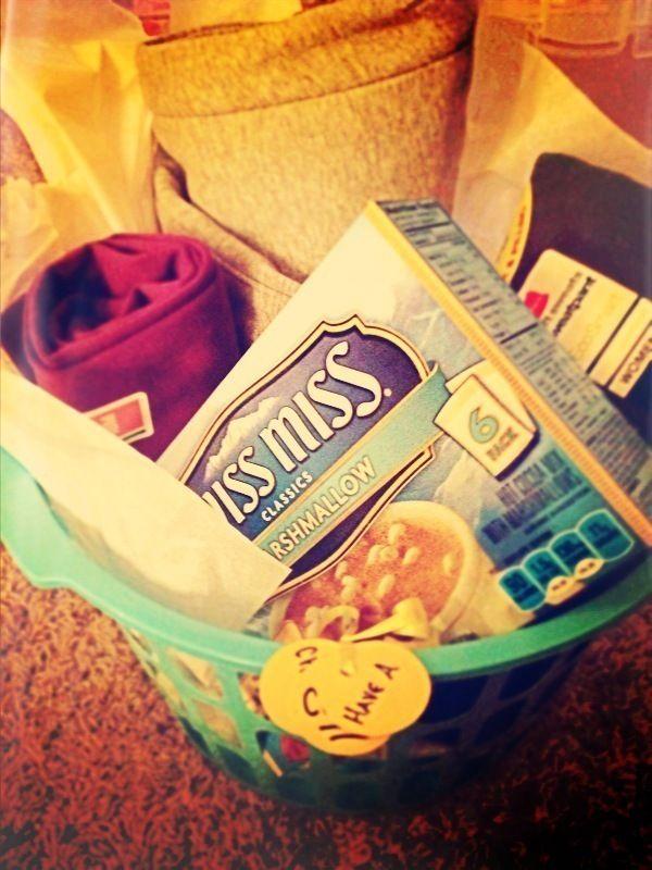 cozy sweat pants gift basket. sweat pants, sweater, blanket, socks, hot cocoa, scarf, mug, etc.