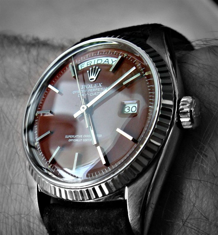 watchanish:  Phew! Ox-blood dialled white gold vintage Rolex Day-Date Presidential (ref: 1807) on a great suede strap.