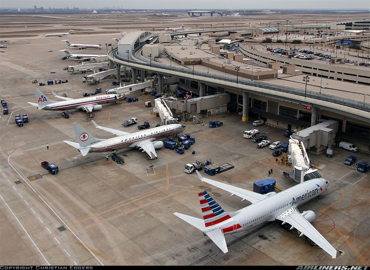 American Airlines' Classic, Actual and Renewed liveries on three different 7hree 737-800 jets lined up at Dallas - Ft. Worth Terminal C.