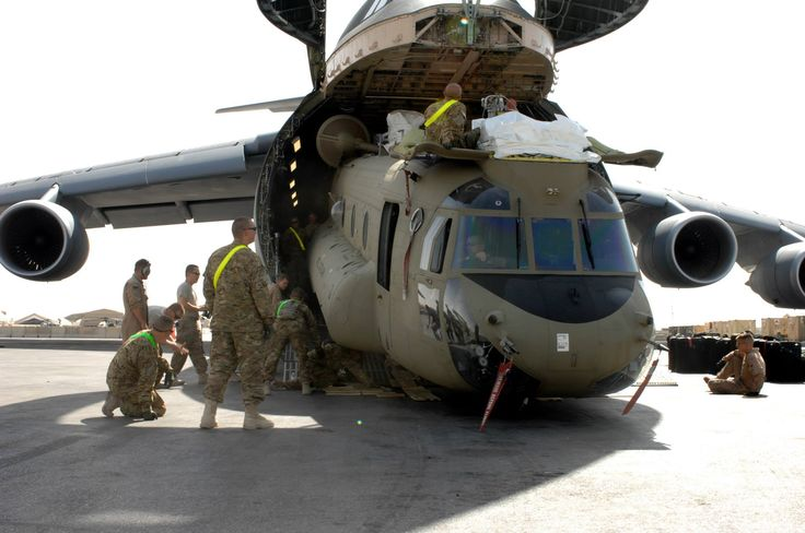 Impressive! This Chinook helicopter is being unloaded from a C-5M Super Galaxy.