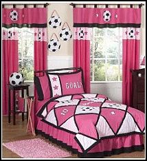 Pink and Black Soccer 4 pc. Twin Bedding Ensemble will add instant Sporty style to your girls room. This Soccer themed childrens bedding set combines the colors of Pink and Black, using solid and plaid 100% cotton fabrics. Through out the set are applique and embroidery work of Soccer Balls and soccer theme words. The comforter is designed using a stylish Pink and Black color combination with large Soccer Ball appliques and a large SOCCER embroidery in a diamond patchwork construction