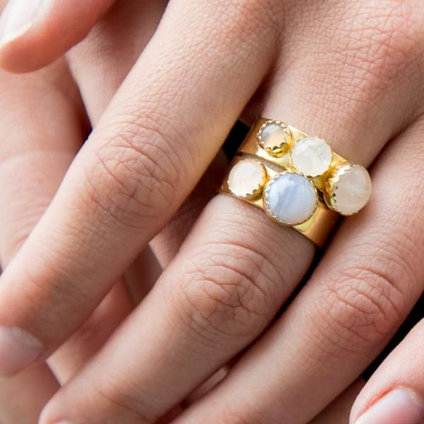 The Tetra Ring pairs a large Rose Quartz stone with a medium size Moonstone and small Chalcedony stone on a thick 14k Vermeil Gold ban.