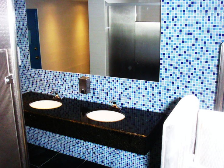 AFTER PICTURE:  Hilton Curacao Casino and Resort with Stainless Steel toilet partitions with diamond finish by www.lockersnmore.com