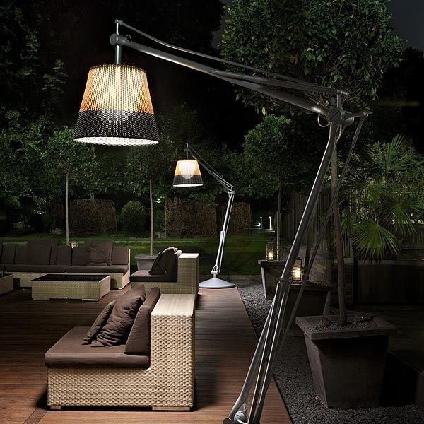 Superarchimoon By Philippe Starck Casts A Bright Glow On This Outdoor Patio  Featuring Modern Lounge Furniture
