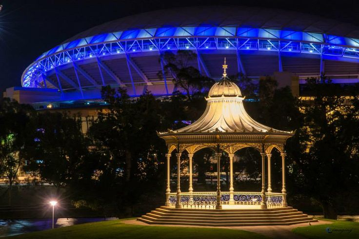"""The """"old"""" rotunda at Elder Park, and the """"new"""" Adelaide Oval."""