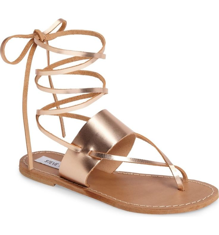Slender laces add of-the-moment appeal to these rose gold sandals that can go from the beach to dressier occasions without fuss.