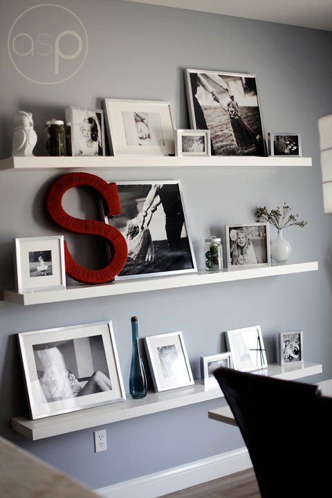 Awesome photo wall with shelves and a monogram.