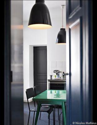 white walls, dark floors, pop of color on the table. avant garde design: some pretties from elle decor, france.