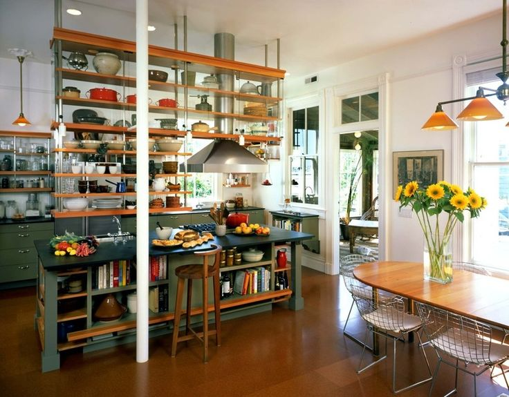 Where seating is not required, think about incorporating bookshelves along the length of your island — perfect for all those cookbooks.