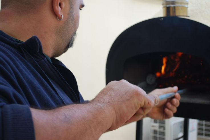 #Lighting wood in the oven #SubitoCotto before #cooking the #cheese