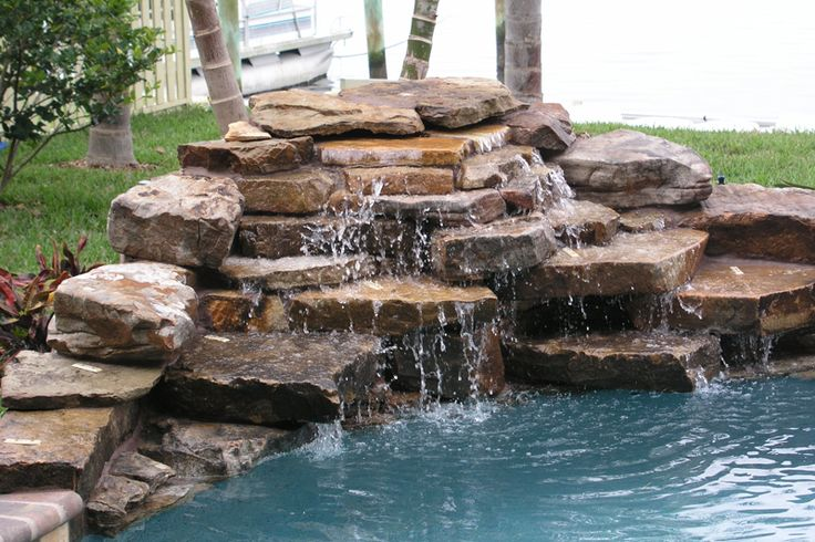 Home pools with a waterfall swimming pool waterfall photo gallery by hartsell pool renovations for Swimming pool fountains waterfalls