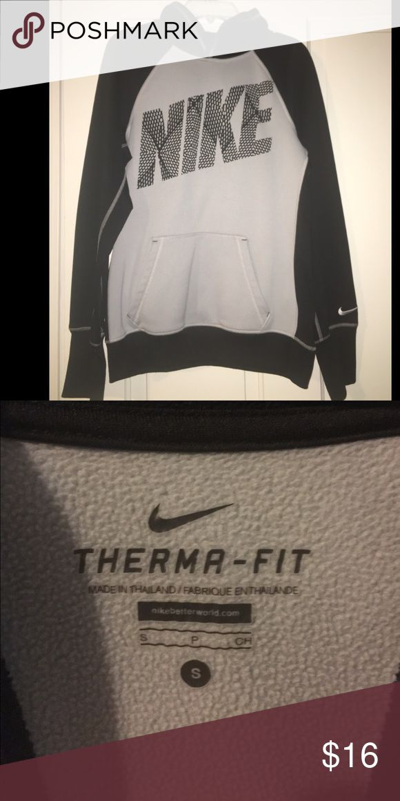 Nike Therma-Fit Hoodie Black and grey Nike hoodie. Feels thin, but keeps you warm on chilly days. Small. More fitted and not loose/oversized. Nike Tops Sweatshirts & Hoodies