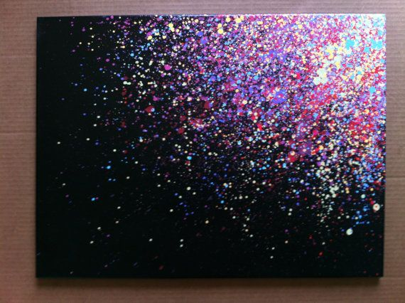 This canvas is made with a combination of different spray paint colors. The splatter effect flows over the edges so theres no need for a frame. Back of the canvas is signed by the artist.