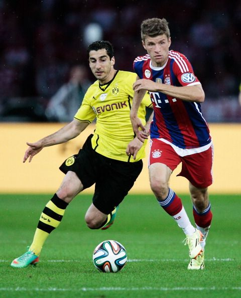 Thomas Muller of Bayern Munich controls the ball during the DFB Pokal final against Dortmund at the Olympiastadion in Berlin