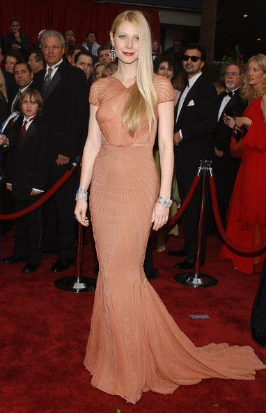 Gwyneth was exquisite at the Academy Awards in a pleated peach gown with a mermaid silhouette. Brand: Zac Posen