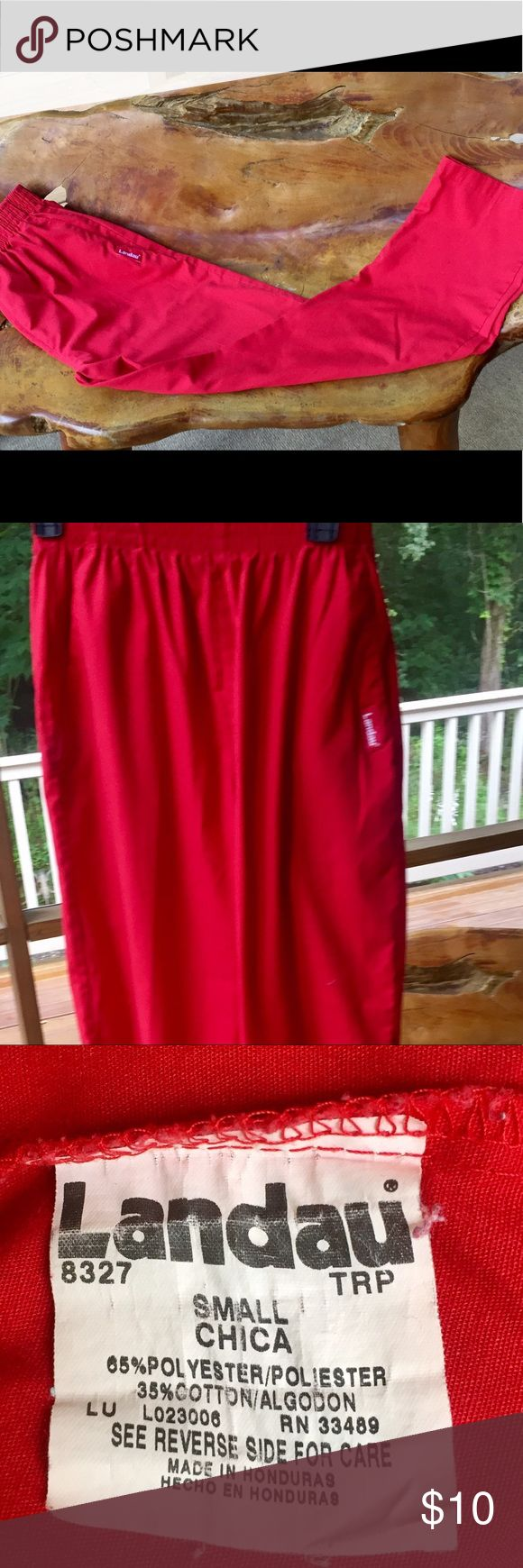 "Bright Red LANDAU Scrub Pants • size SMALL This is a great pair of red scrub pants by LANDAU.  These are size SMALL.  They have a wide elastic waistband and two front slash pockets.  The inseam measures 28"" and the leg opening measures 8"".  These are 55% polyester and 35% cotton.  No issues noted. SMOKE FREE HOME. I love to BUNDLE! Landau Pants"