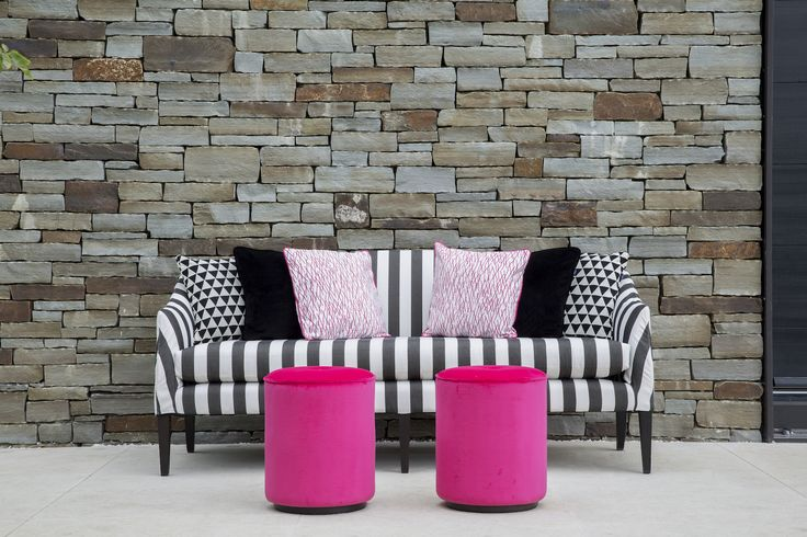 Coco Wolf outdoor Mamelle sofa with Delano drums in Perennials outdoor fabrics.