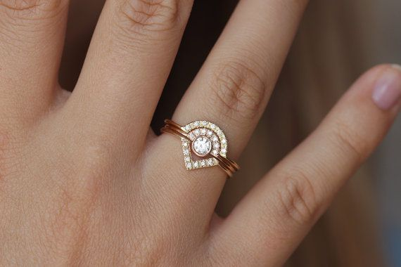 Diamond engagement ring in 18k solid gold with a pave diamonds crown. Thin and dainty design. Clear and sparkly diamonds. The ring on the photo is shown $1200