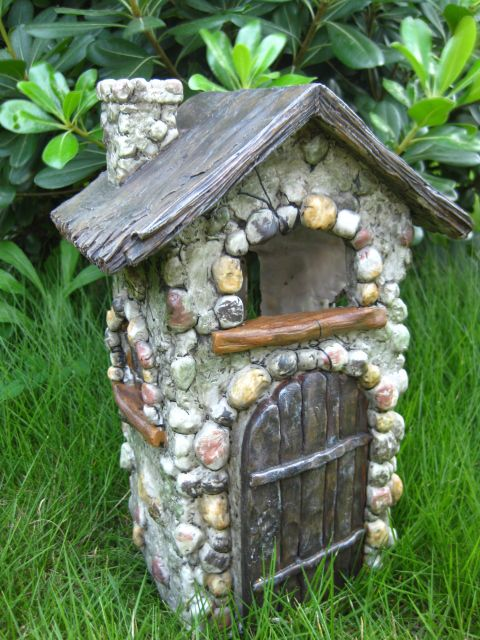 Fairy House. Looks like you could make this with a milk carton and pebbles etc.