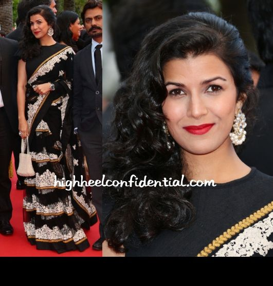 Nimrit, who is in Cannes for her movie Lunchbox attended the 'Inside Llewyn Davis' Premiere with her fellow actors. For the red carpet, it was a Sabyasachi sari lehenga with earrings by Amrapali with red lips to complement the black and white look.