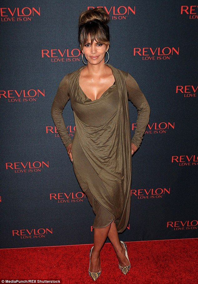 Beautiful in bronze: Halle Berry looked fantastic as always as she arrived on the red carpet of the Revlon Love Is On Million Dollar Challenge event in New York City on Wednesday night