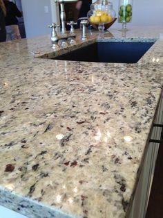 crema pearl granite with white cabinets