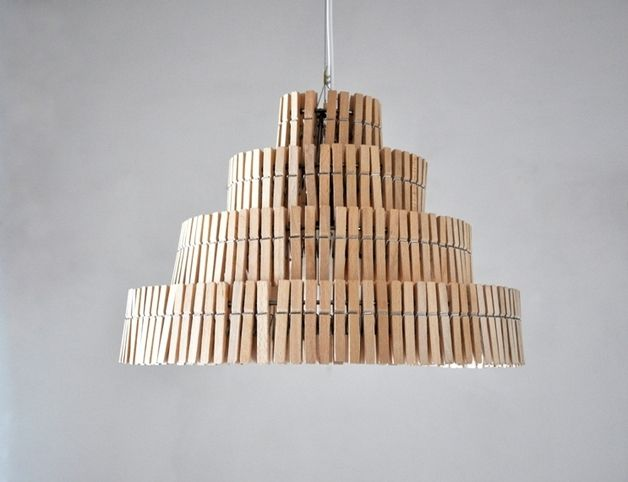 Ceiling light made with wooden clothes clips. It makes a beautiful and soft shadow when it's turned on. Totally handmade – a unique product by crea-re via en.DaWanda.com