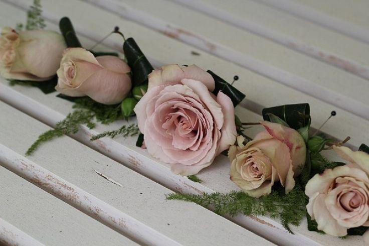 pink buttonhole www.wanakaweddingflowers.co.nz/gallery.php