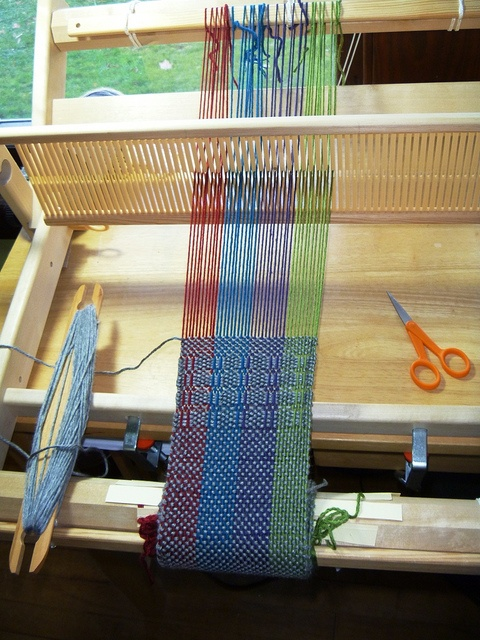 Multi-colored scarf by workingyarn, via Flickr