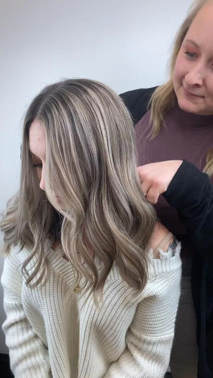 Ashe blonde highlights with dimensional lowlights for naturally brown hair with a long bob haircut #longbobhaircut