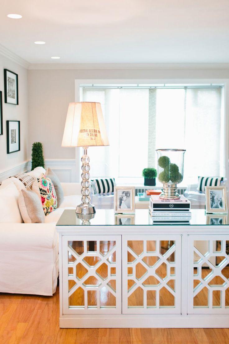 cozy and feminine living room    white sofa    mirrored sideboard