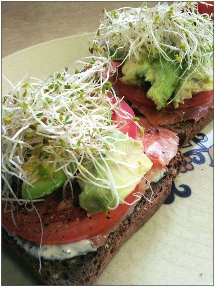 Smoked salmon, tomato, avocado and alfalfa open sandwiches with lemon ...
