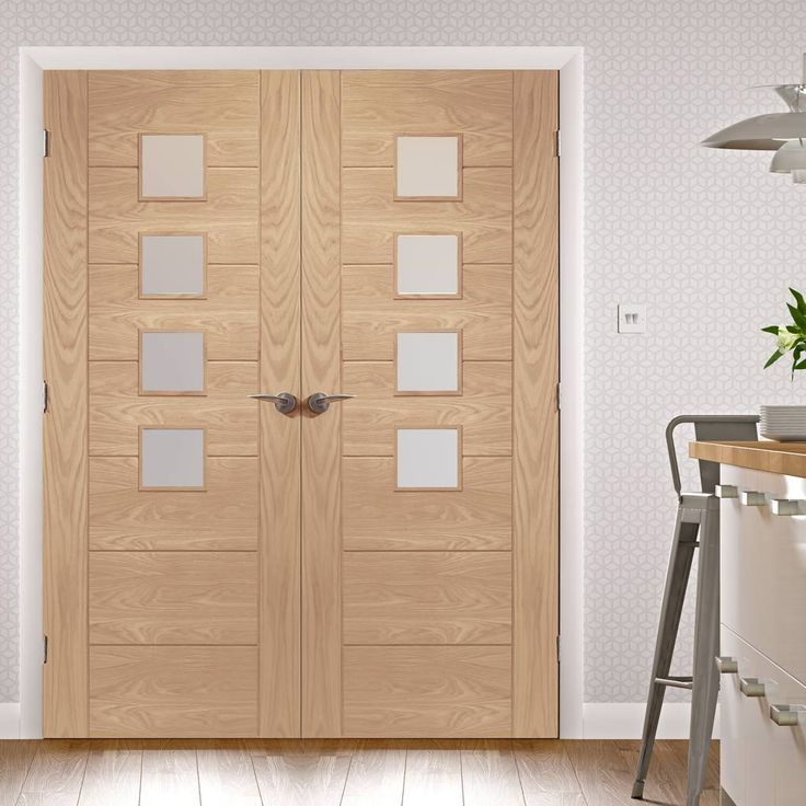 Palermo oak fire door pair with obscure safety glass, 30 minute fire rated, machined feature grooves and raised beading around each glass pane. #firedoors #firedoorpair #internalfiredoors