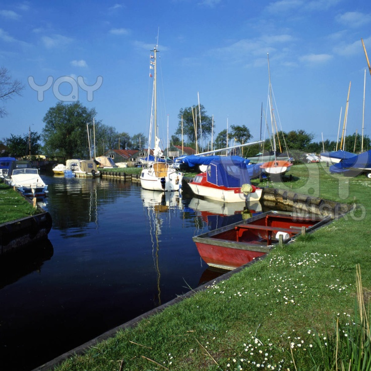 Boats on Hickling broad in the Norfolk Broads, England.