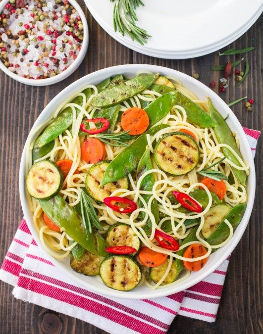Whole grain pasta topped with grilled seasoned vegetables. A colorful and healthy vegetarian entrée.