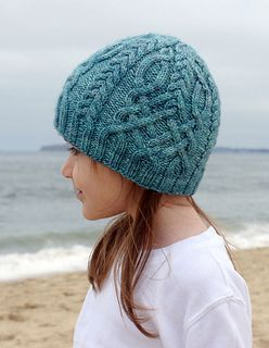 Holy cow! Cable challenge | Snowstorm hat is a seamless hat knit from the bottom up with lots of cables.