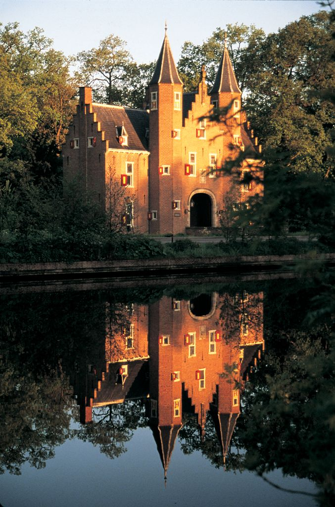 I want to live in a castle...in Holland... with tulips and windmills!! :)     Kasteel Nijenrode (Photo: Holland.com)