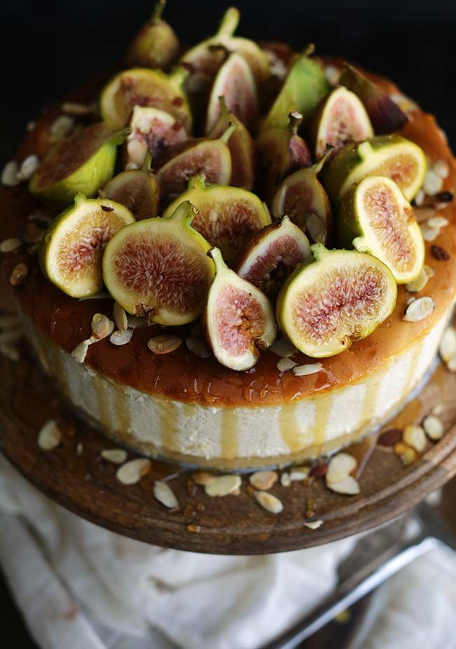 This Italian Ricotta Cheesecake Recipe with Fresh Figs, Honey and Almond Crust is where it's at!  A perfect balance of savory and sweet! #cheecake #ricottacheesecake