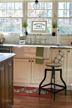 Farmhouse style apron front farm sink in a DIY white kitchen - www.goldenboysandme.com