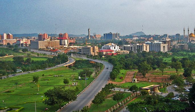 Abuja is the capital of Nigeria. It is surprisingly filled with many beautiful parks, which match the tropical weather perfectly. One of these is Millenium Park - http://www.abuja-ng.com/millennium-park.html. Interesting Fact: Abuja was chosen as a capital city after Lagos for its location near the center of the country, its good climate, and small population (which is now ironically growing).