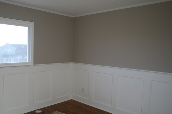 Gray Nursery with White Wainscoting