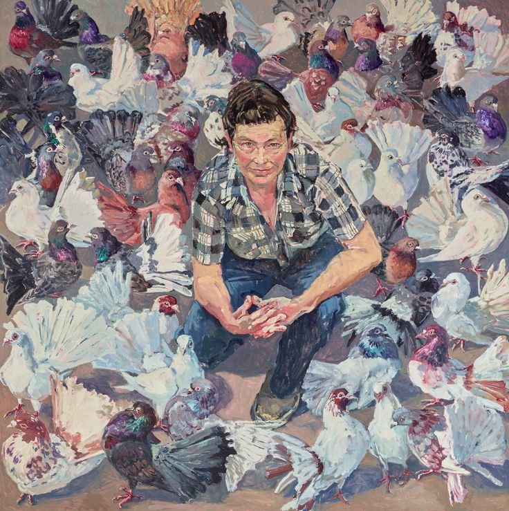Lucy Culliton frequently paints self-portraits that reference the subject she is currently exploring in her art. At the moment she is painting animals and is pictured here in a sea of fantail pigeons, all of which belong to her.