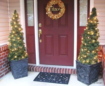 See the beautiful potted pine decorations? They're not trees!! They're tomato cages wrapped with garland and lights! haha What a great way to save a good hundred bucks by spending maybe $10?