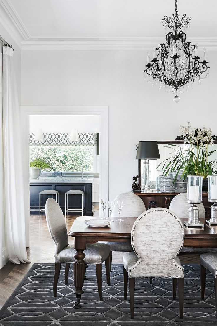 A silver-accented dining room featuring a custom Highgate House rug, antique furnishings and upholstered dining chairs adds to the luxe feel of this colonial-style Queenslander. Photography: Maree Homer | Stylist: Kate Nixon | Story: Australian House & Garden